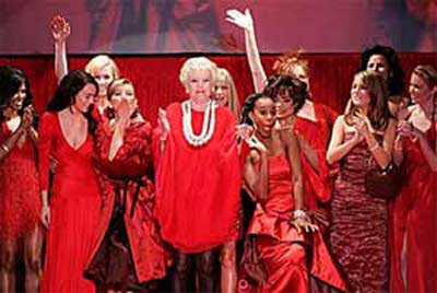 Female musical artists celebrate the conclusion of The Heart Truth's Red Dress Collection 2006 Fashion Show on the runway at Olympus Fashion Week.  Wearing red dresses designed by America's top fashion houses including Amerie for Tommy Hilfiger (far left), Elaine Stritch for Charles Nolan (center left), Kelly Rowland for House of Dereon (center right), and Nelly Furtado for Betsey Johnson (far right).