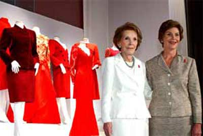 Heart Truth ambassador Mrs. Laura Bush (right) and former First Lady Nancy Reagan (left) commemorate the unveiling of the First Ladies Red Dress Collection at the John F. Kennedy Center for the Performing Arts.  The display features red dresses and suits donated from all seven of America's living First Ladies in support of The Heart Truth.