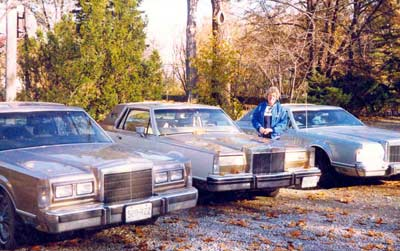 Helen Bacon with her big Cadillac cars