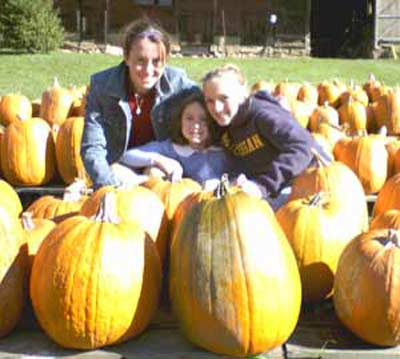 Lisa Spicer daughters in the pumpkin patch