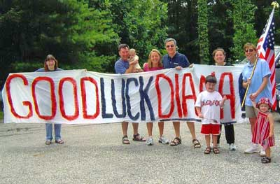 Diana Munz family holding Good Luck sign