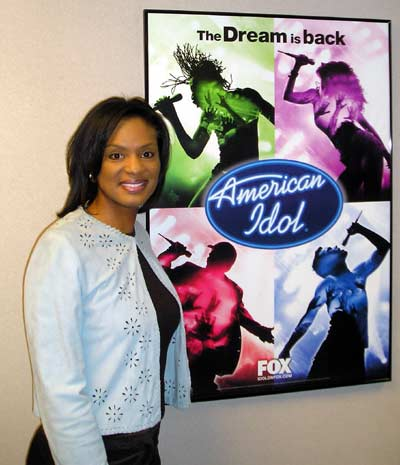Stacey Bell with American Idol poster