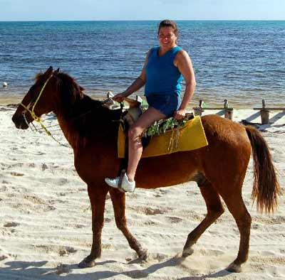 Sue Lanphear on horseback on the beach